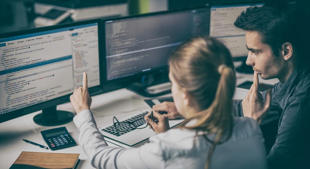 National coding week - two developers analysing code